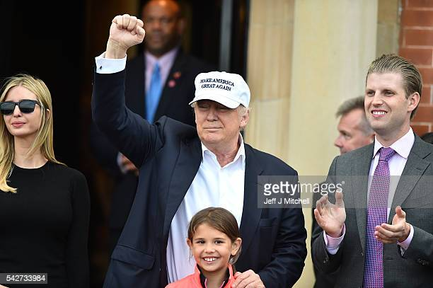 Presumptive Republican nominee for US president Donald Trump surround by his family his son Eric Trump granddaughter Kai Trump and daughter Ivanka...