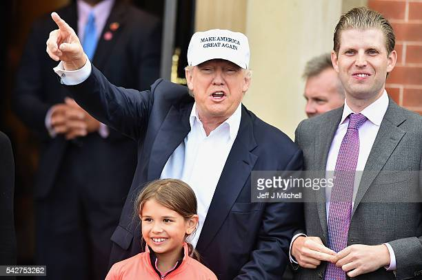 Presumptive Republican nominee for US president Donald Trump with son Eric Trump and granddaughter Kai Trump arrive at his Trump Turnberry Resort on...