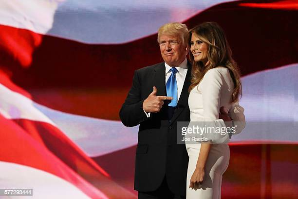 Presumptive Republican presidential nominee Donald Trump gestures to his wife Melania after she delivered a speech on the first day of the Republican...