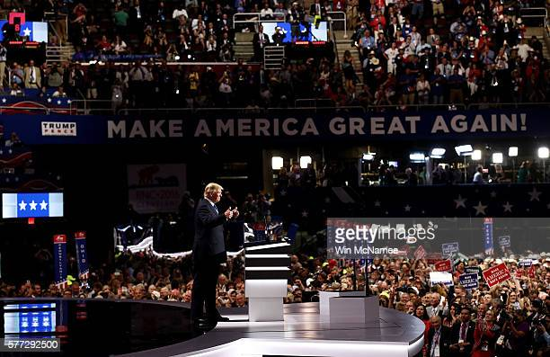 Presumptive Republican presidential nominee Donald Trump gives a thumbs up while introducing his wife Melania on the first day of the Republican...
