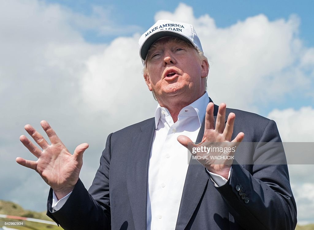 Presumptive Republican presidential nominee Donald Trump speaks to members of the media during a tour of his International Golf Links course north of Aberdeen on the east coast of Scotland on June 25, 2016. Donald Trump hailed Britain's vote to leave the EU as 'fantastic' shortly after arriving in Scotland on Friday for his first international trip since becoming the presumptive Republican presidential nominee. / AFP / Michal Wachucik