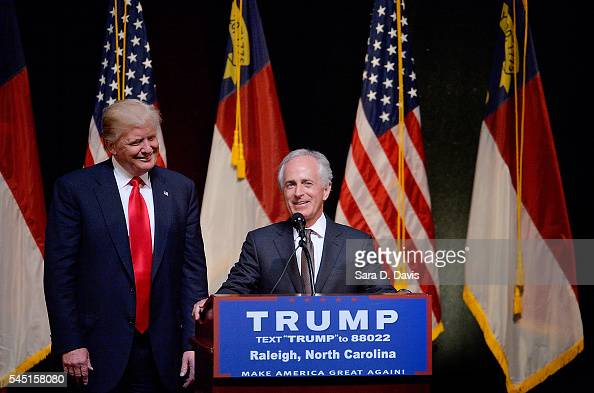 Presumptive Republican presidential nominee Donald Trump stands next to Sen Bob Corker during a campaign event at the Duke Energy Center for the...