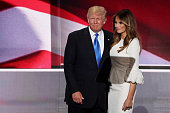 Presumptive Republican presidential nominee Donald Trump stands with his wife Melania after she delivered a speech on the first day of the Republican...