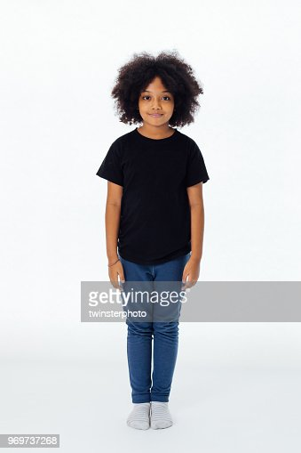 Pre-teen African American kid in casual style standing still isolated in white background : Stock Photo