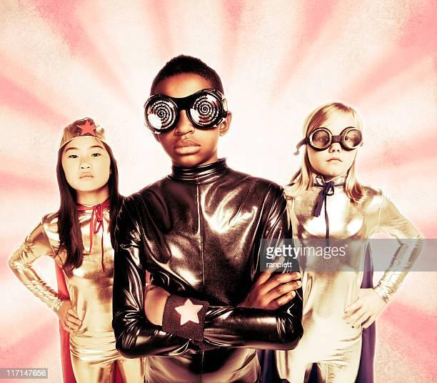 Preteen Children Dressed as Superheroes