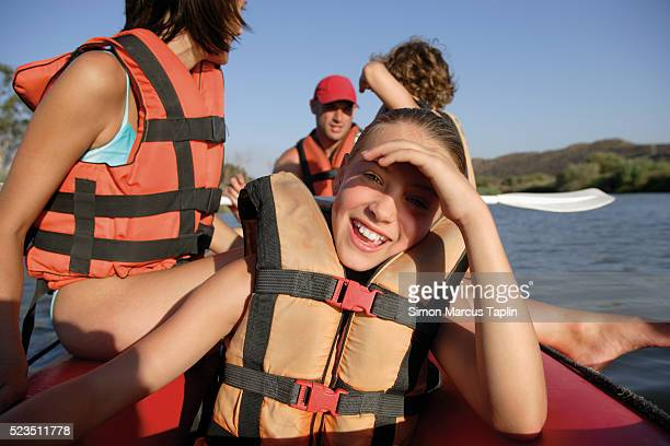 Pre-Teen Girl Enjoying Rafting Trip with Family