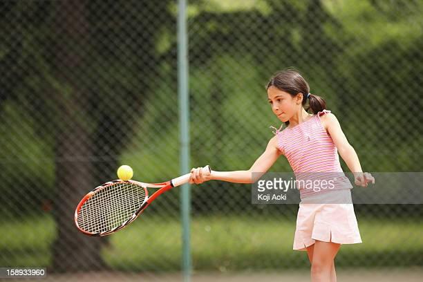 Preteen Girl Hitting Forehand Shot