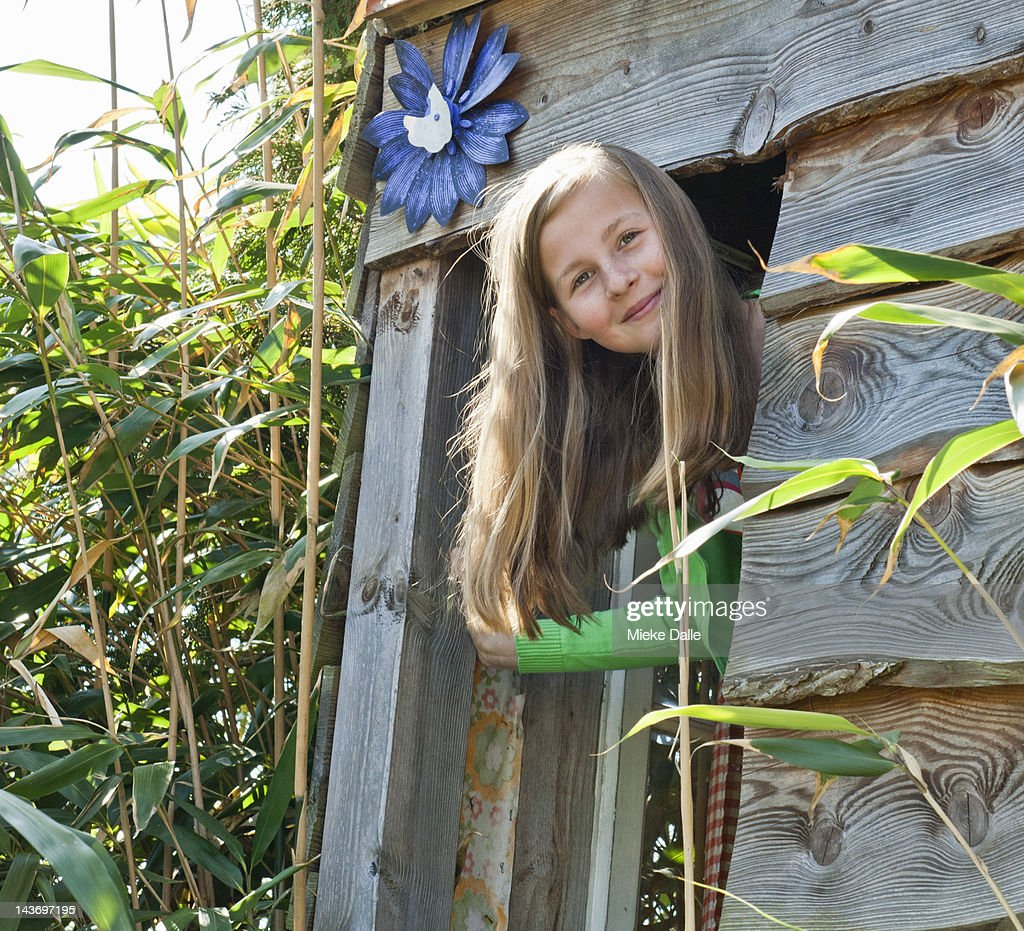 Pre-teen girl in a treehouse : Stock Photo