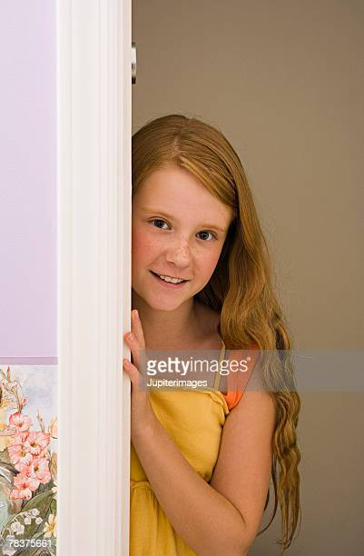 Preteen girl in doorway