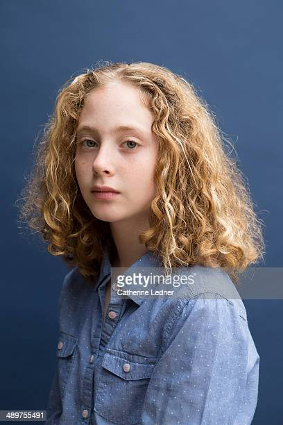 Pre-teen girl on blue background