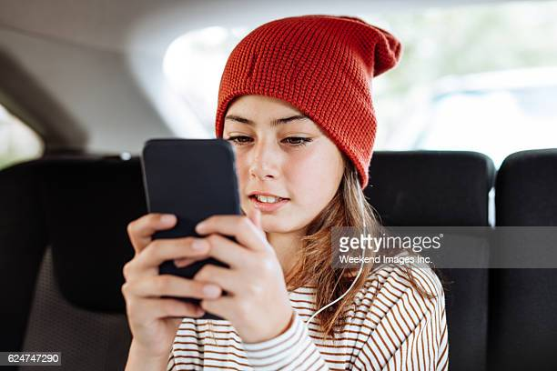 Pre-teen girl with cell phone
