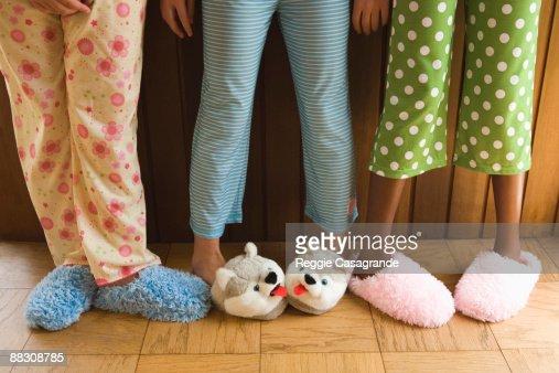 Pre-teen girls wearing fuzzy slippers