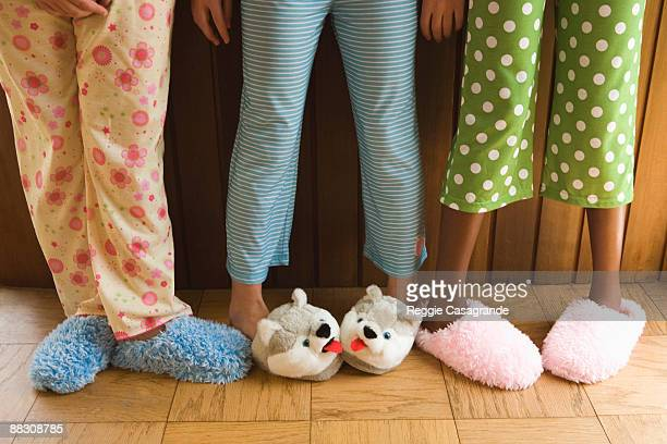 Pre-teen girls wearing fuzzy slippers
