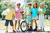 Pre-teens with sports equipment