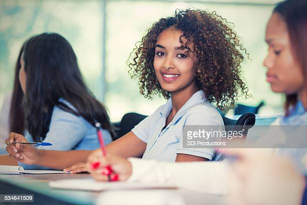 Pretty African American teen student in private high school