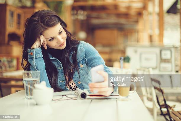 Pretty and young designer in a coffee shop