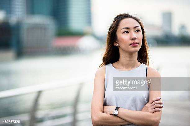 pretty asian woman standing outdoors