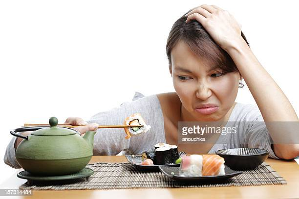 Pretty asian woman tired of japanese food