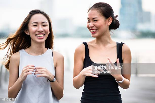pretty asian women talking outdoors