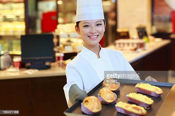 pretty baker showing bread