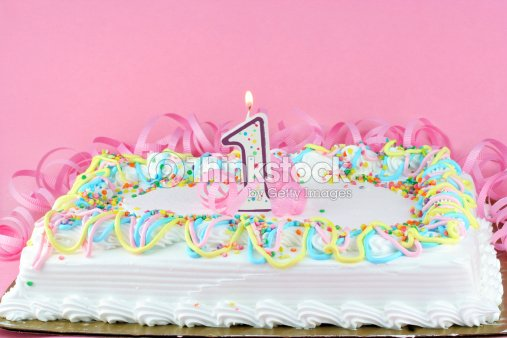 Pretty Birthday Cake Decorated And With One Lit Candle