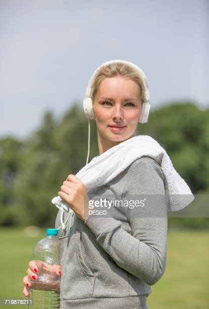 Pretty blonde woman doing sport in park