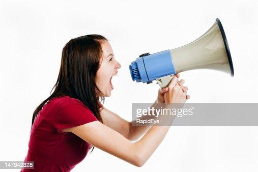 Pretty brunette yells into loud hailer : Stock Photo