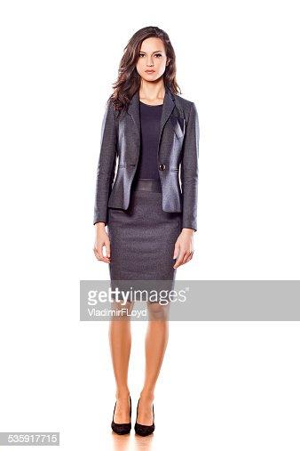 Pretty negocios mujer posando sobre fondo blanco : Foto de stock