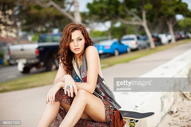Pretty, Cute Model Sitting At Beach In Sun