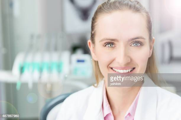 Pretty doctor smiling at camera