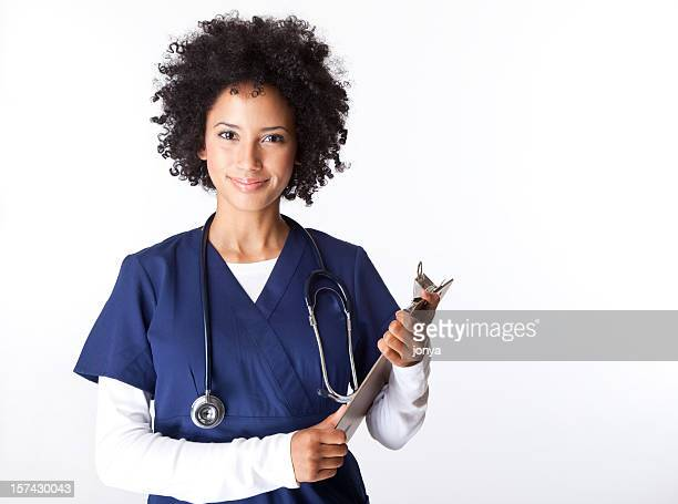 pretty female nurse with curly hair holding clipboard