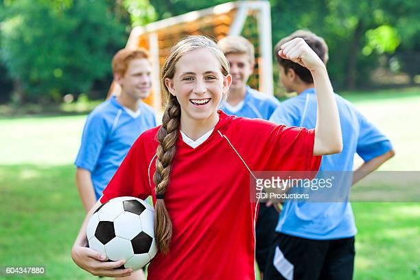 Pretty female soccer athlete celebrates victory