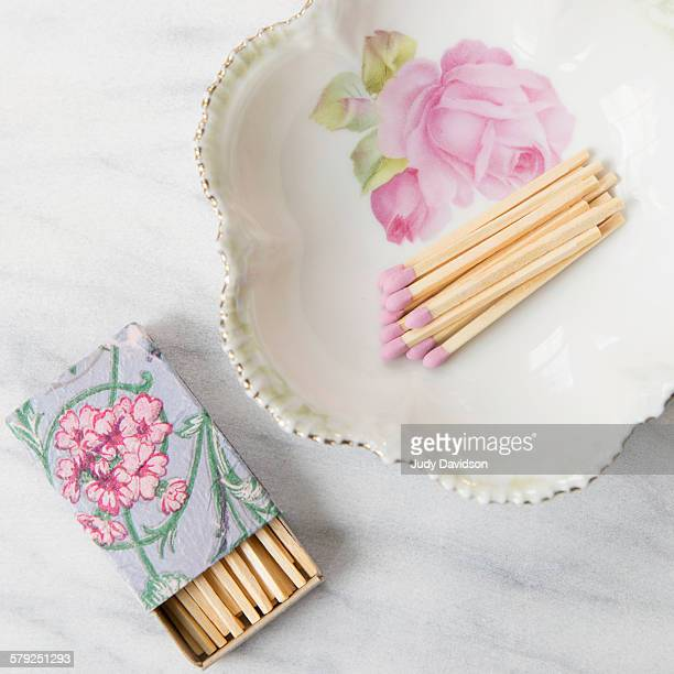 Pretty floral plate with pink tipped matches
