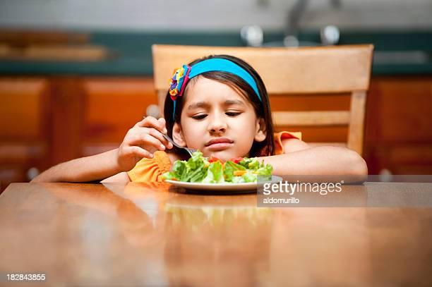 Pretty giel disliking her salad