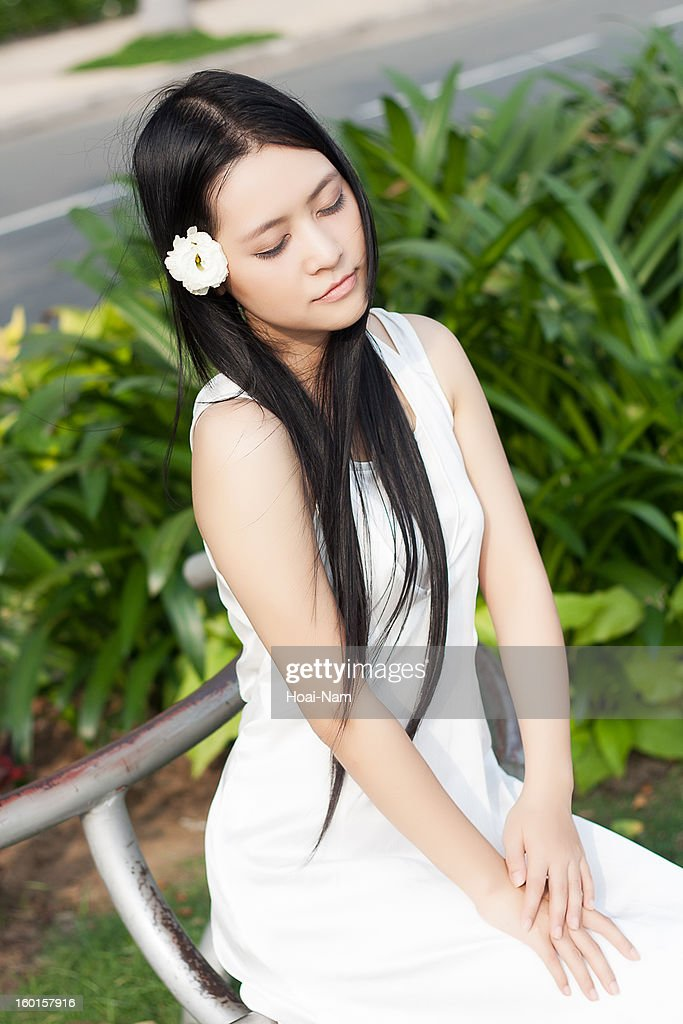 Pretty girl feeling the wind : Stock Photo
