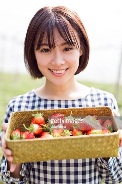 pretty girl in strawberry farm
