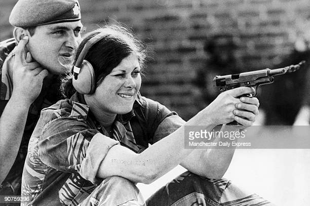 �A pretty girl learns to shoot under the experienced eye of a Rhodesian Army instructor Increased guerrilla attacks have meant that women are taking...