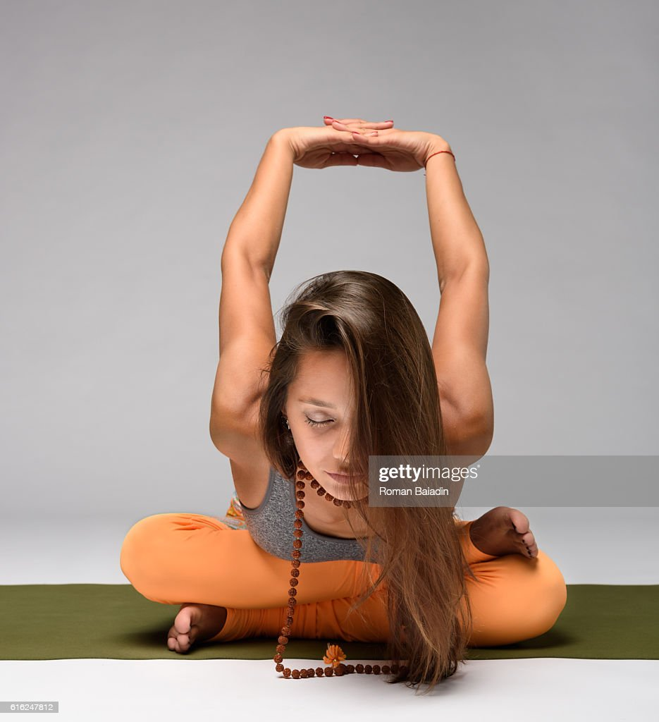 Pretty girl practicing yoga : Stock Photo