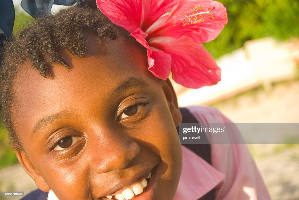 pretty girl with flower in hair smiling