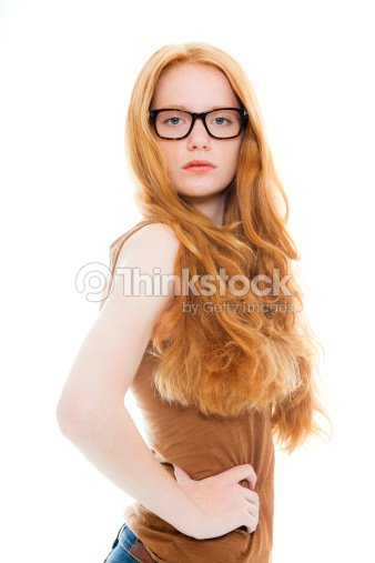 Pretty Girl With Long Red Hair Wearing Retro Glasses Stock Photo