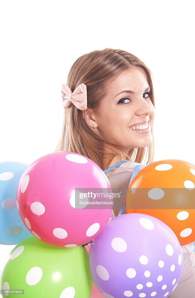 Menina bonita com balões Multicor : Foto de stock
