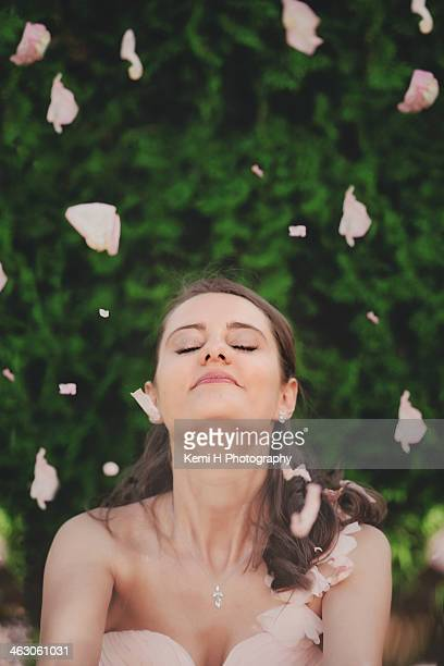 Pretty girl with rose petals