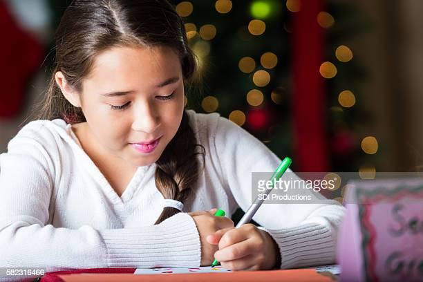 Pretty girl writes letter to Santa