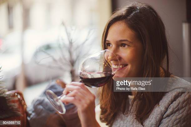 Pretty happy woman drinking wine