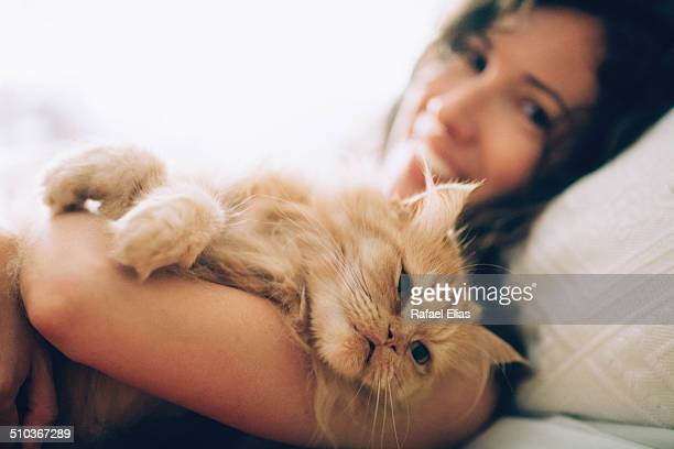 Pretty happy woman holding cat