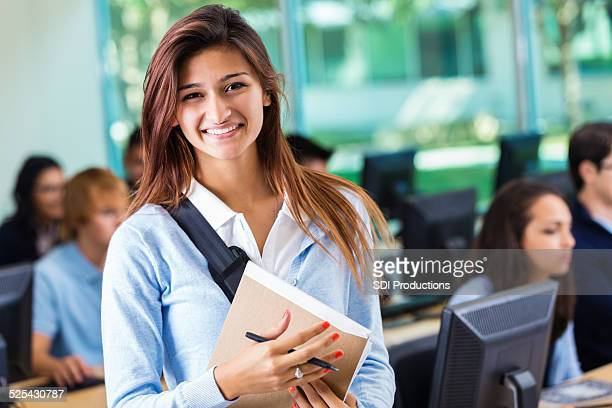 Pretty Hispanic student in private college prep school computer class