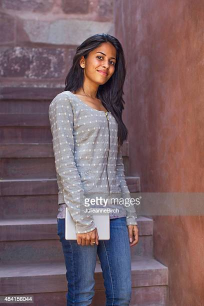 Pretty Indian student on staircase