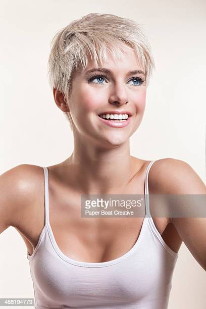 Pretty lady with short blonde hair, smiling