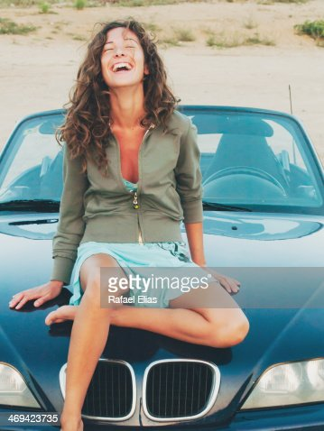 nude girls sitting on cars