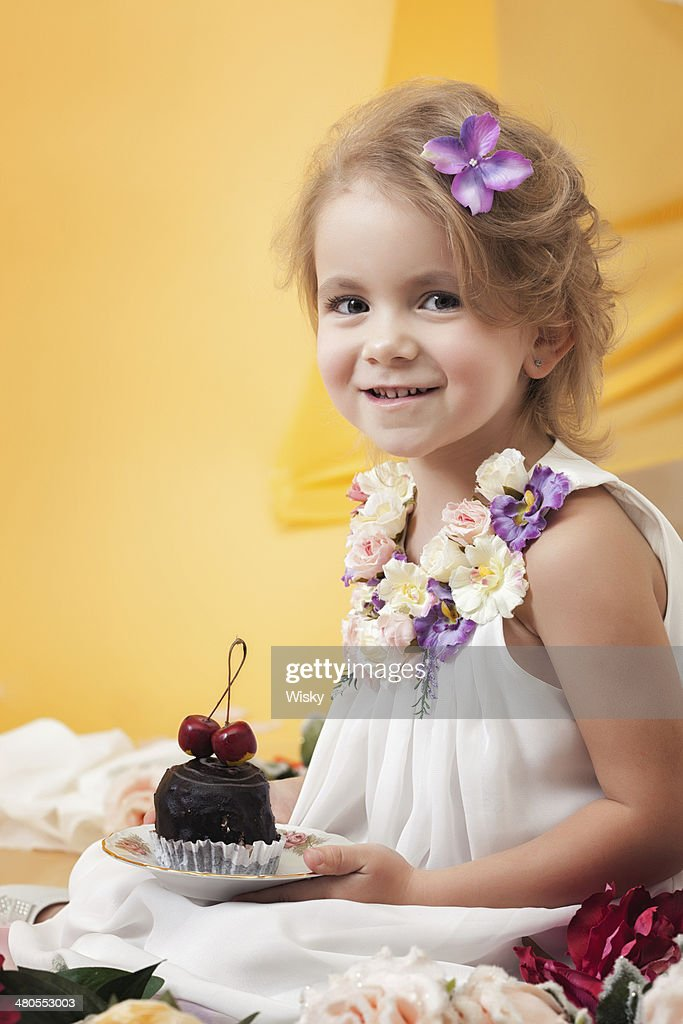 Pretty little girl posing with chocolate cake : Stock Photo